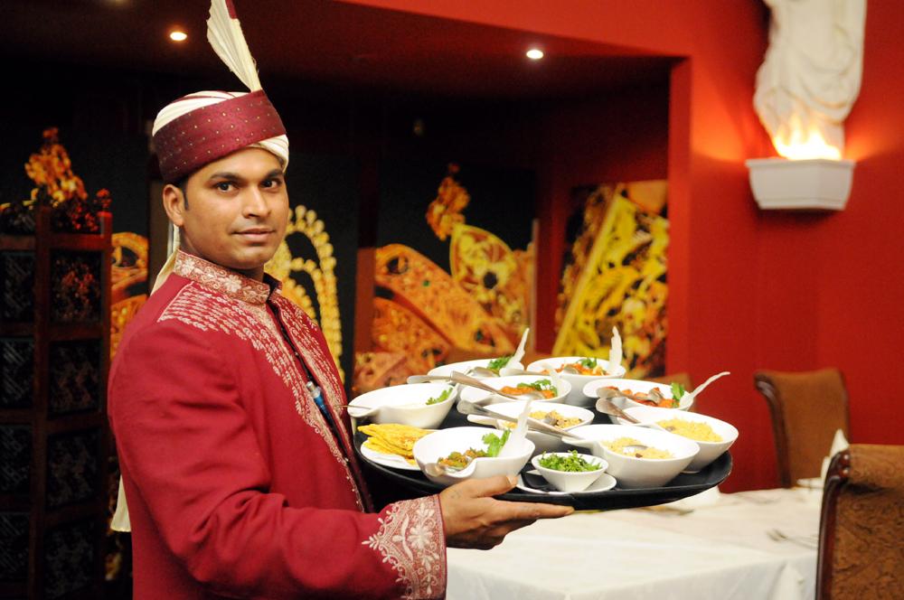 man-serving-food